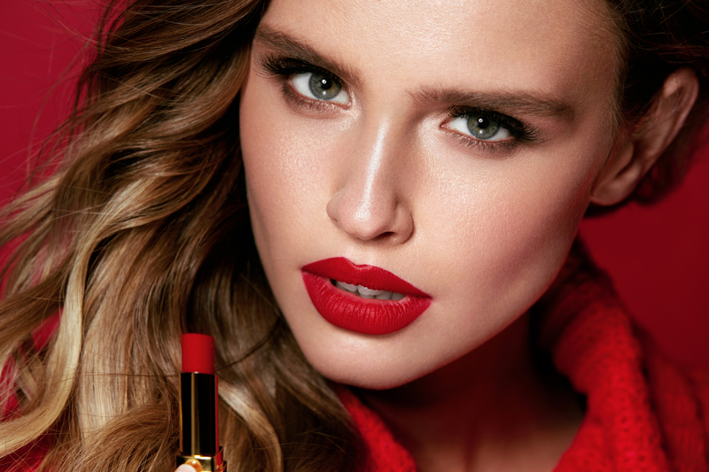 Red Lips. Beautiful Woman With Beauty Makeup Holding Lipstick. Close Up Of Sexy Young Glamorous Female Model With Bright Facial Makeup And Soft Fresh Healthy Skin. Cosmetics. High Resolution.